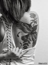 Girl Showing Back Shoulder Tattoos
