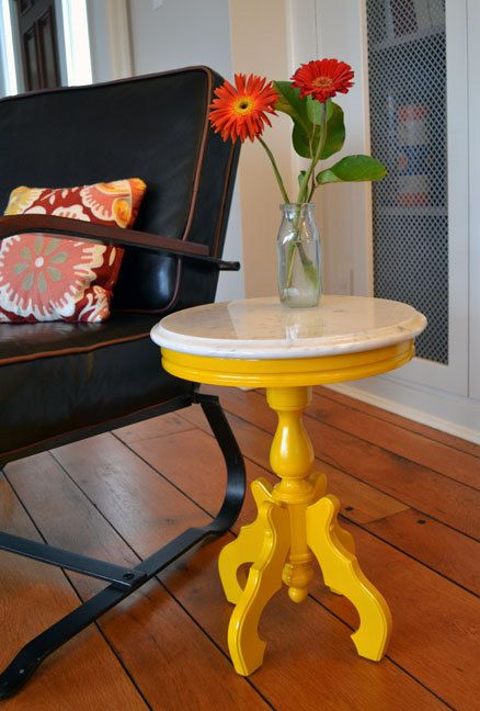 Bought a similar table today for $2 at Value Village; thinking yellow is actually cute! It has a glass top that you can change out the fabric behind it. Any suggestions?