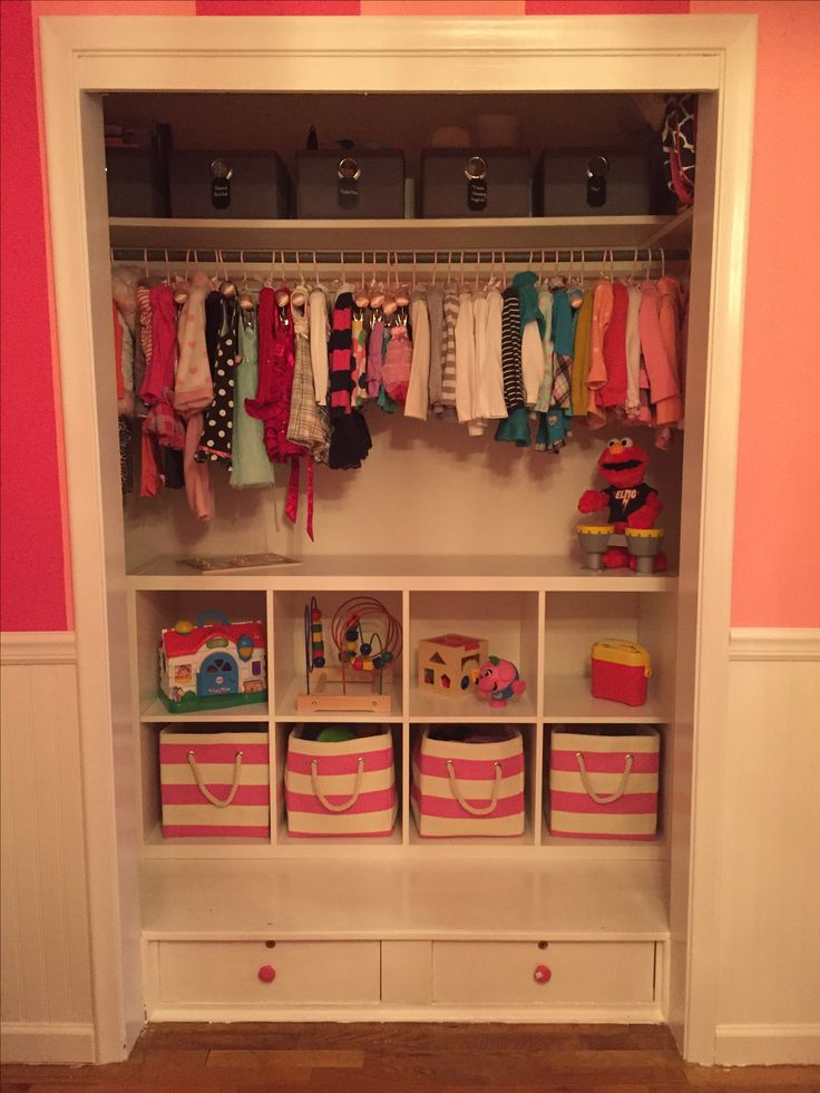 Toddler closet organization. Ikea shelving. Land of Nod baskets.
