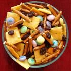 Kids' Party Mix      Ingredients   1 1/2 cups candy-coated chocolate pieces   3 cups thin pretzel sticks, broken in half   3 cups bite-size Cheddar cheese crackers   1 1/2 cups raisins           Directions:  1. Mix chocolate candies, pretzels, crackers, and raisins together and store the mixture in a tightly covered container. Serve as a snack.         Nutritional Information:   Amount Per Serving  Calories: 419 | Total Fat: 12.9g | Cholesterol: 8mg