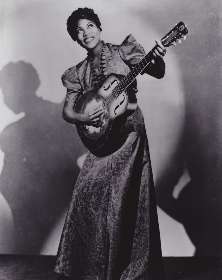 """Guitarist, Singer, Songwriter, & """"Godmother of Rock-n-Roll"""" Sister Rosetta Tharpe. As a pioneer in the genre her signature blend of gospel hymns over secular rhythms made Tharpe the first artist to chart with spiritual recordings. Music legends Elvis Presley, Jerry L. Lewis, Little Richard, and Johnny Cash considered her a source of their personal inspiration and influence. Inducted into the Blues Hall of Fame in 2007 and January 11th, 2008 was declared Sister Rosetta Tharpe Day in…"""