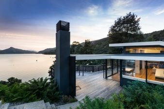 Large decking areas and floor to ceiling windows ensure the water is always in view