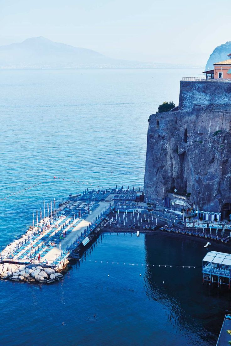 ❄🌷View of the swimming deck, with Mount Vesuvius in the background, from La Minervetta hotel in Sorrento, Italy... ❄🌷