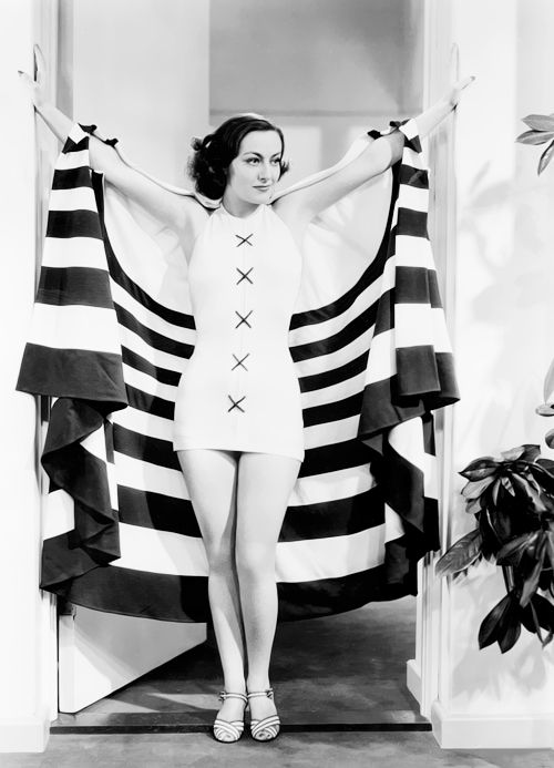 Joan Crawford in a bathing suit designed by Adrian for No More Ladies, 1935