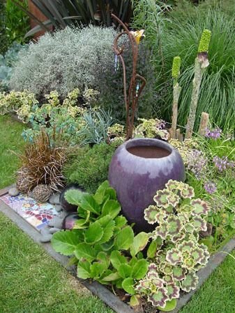Small garden ideas -Surrounding this beautiful pot with strong plant material works in this design. Very nice.