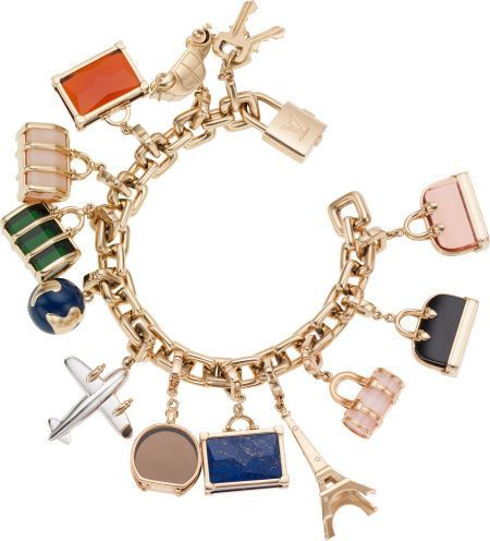 I love this Louis Vuitton 18K Yellow Gold World Travel Charm Bracelet with Lock, Key and Twelve Diamond, Onyx, Lapis & Topaz Charms