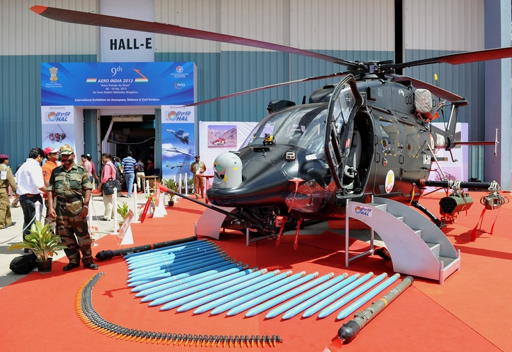 The HAL Rudra helicopter is pictured with an assorted display of armament during Aero India 2013 at the Yelahanka Air Force station in Bangalore on February 6, 2013. The HAL Rudra is an armed version of the Dhruv multirole/utility helicopter manufactured by the Hindustan Aeronautics Limited company