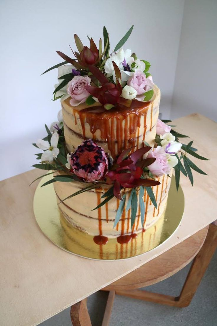Large two-tiered semi-naked Wanaka Wedding cake with caramel drips and beautiful flowers