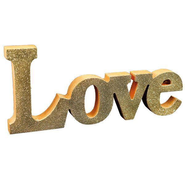 Inka Goldin ja kimalteisen kohopulverin avulla valmistettu LOVE-teksti.