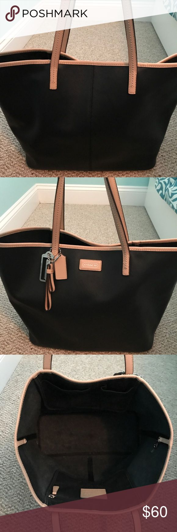 Coach Tote Bag Black large spacious Coach Tote bag with tan trim. Great for every day use, carrying books/ laptop for class or work, and traveling Coach Bags Totes