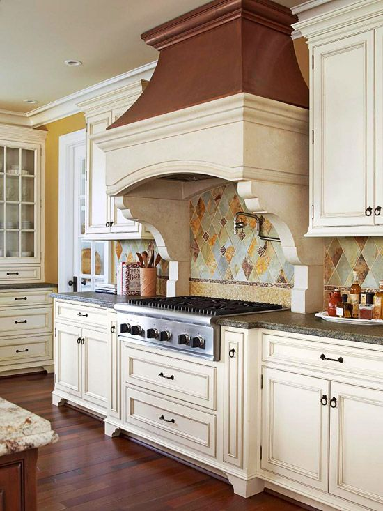 love the tile work... I think I'd be intimidated by this kitchen, though, I'd be afraid to get it dirty :]