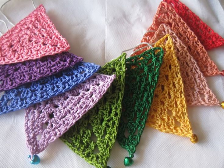 Rainbow bunting crochet triangles with little bells to chime in the breeze ;0)   Free pattern