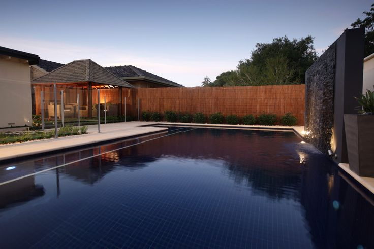 The dramatic effect of white step treads in a very dark blue pool