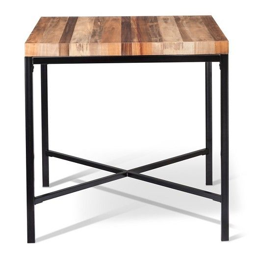 Rustic meets contemporary in the gorgeous Asmara Counter Height Table. This stylized piece of home furniture combines the best of both worlds with its streamlined design and attractive reclaimed wood-look construction. Featuring a sleek woodblock top ideal for everything from chopping vegetables to serving snacks to displaying decorative items, a painted metal frame with a criss crossed base and a square design that fits nicely in any room in the house.