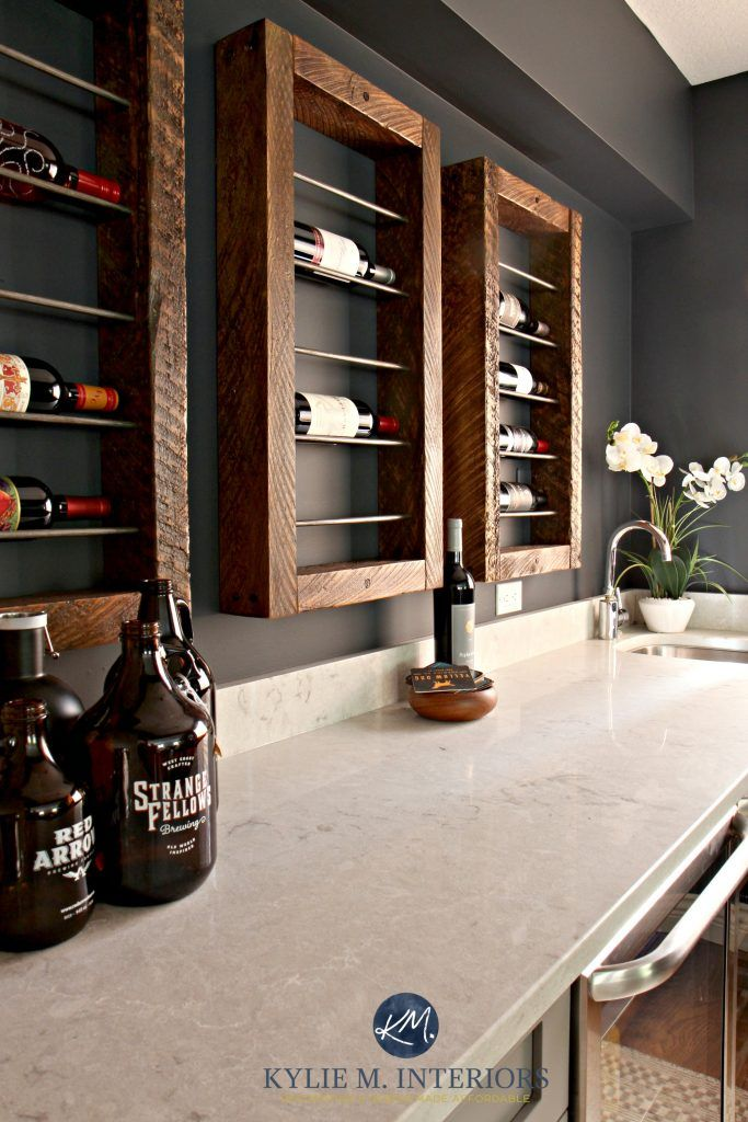 Bianco Drift Quartz countertops. Wine bottle wall display. Sherwin Williams Cyberspace paint colour. Kylie M Interiors E-design and Online Color Consulting expert