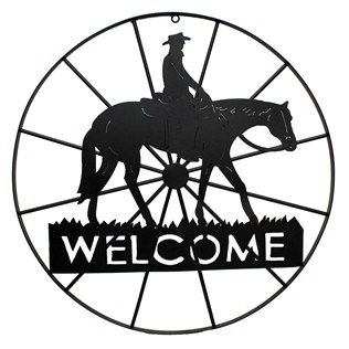 Circle up the wagons and give a warm cowboy welcome with this metal wagon wheel sign!| Shop Hobby Lobby