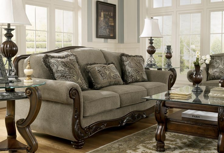 Martinsburg Meadow Traditional Camel Back Sofa With Exposed Wood Trim By Signature Design By