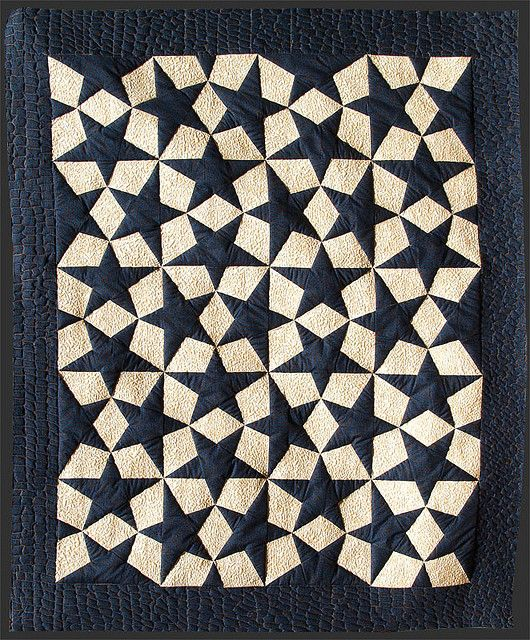 """""""Estrellas Escher"""" quilt from Arte Patchwork. This seemingly complex design is actually made with 20 identical blocks."""