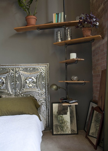So simple, and even a bit odd-looking, but I still like individual details of this (though not all together): headboard, brick wall, painted wall color, shelf, purple flowers, other potted plant.