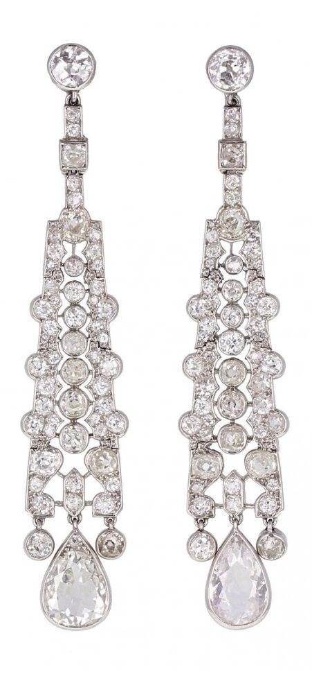 Cartier - An exquisite pair of Belle Epoque platinum and diamond earrings, circa 1900. Fashioned from platinum, the pierced, articulated panels set with old mine-cut diamonds, tapering in size to a final drop pear-shaped diamond. Thumb-screw type fittings. Signed Cartier. #Cartier #BelleÉpoque