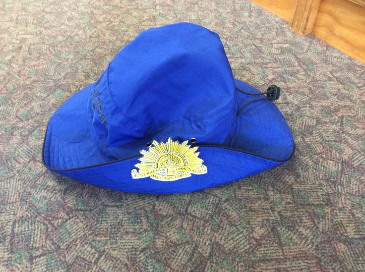 A Rising Sun badge coloured by the students and pinned to their school hats to resemble slouch hats.