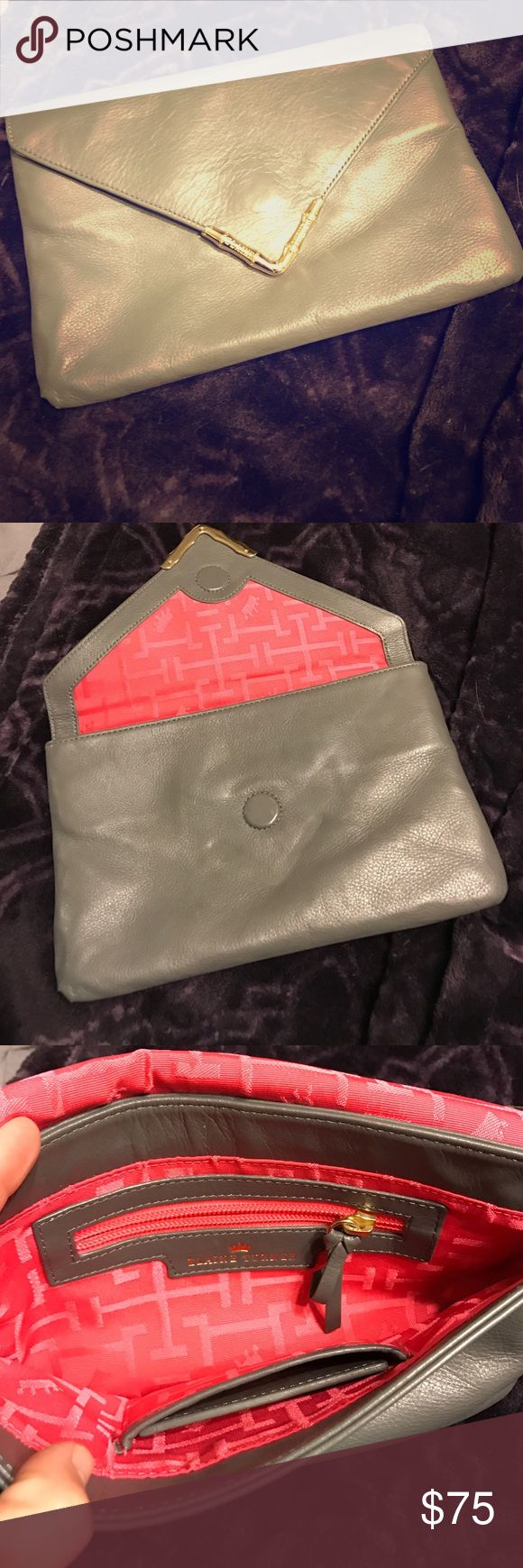 Elaine Turner Grey Clutch! Elaine Turner Grey Clutch-slightly used, normal wear. No tears or stains. Grey in color with magnet closing. Inside is hot pink. Small mirror included in size pocket. Great for every day use or a night out! Elaine Turner Bags Clutches & Wristlets