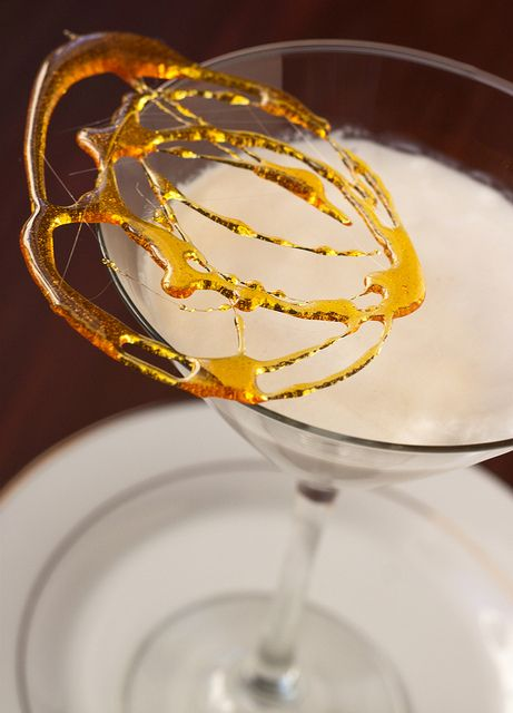 White Chocolate Creme Brûlée Martini  Ingredients:  ~Martini  >3 ounces vanilla vodka  >1 1/2 ounces white chocolate liqueur  >1/2 ounce butterscotch schnapps  >1/2 ounce heavy cream  ~Garnish  >2 tablespoons granulated sugar
