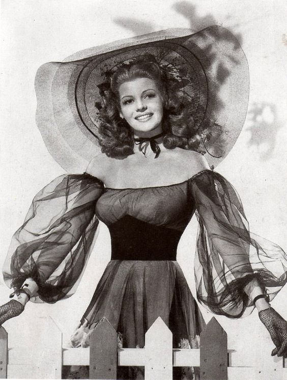"""Rita Hayworth looking picture perfect: from the 1944 movie: """"Tonight and Every Night"""" which was about The Windmill theatre in London and performers there who refused miss a performance throughout the Blitz."""