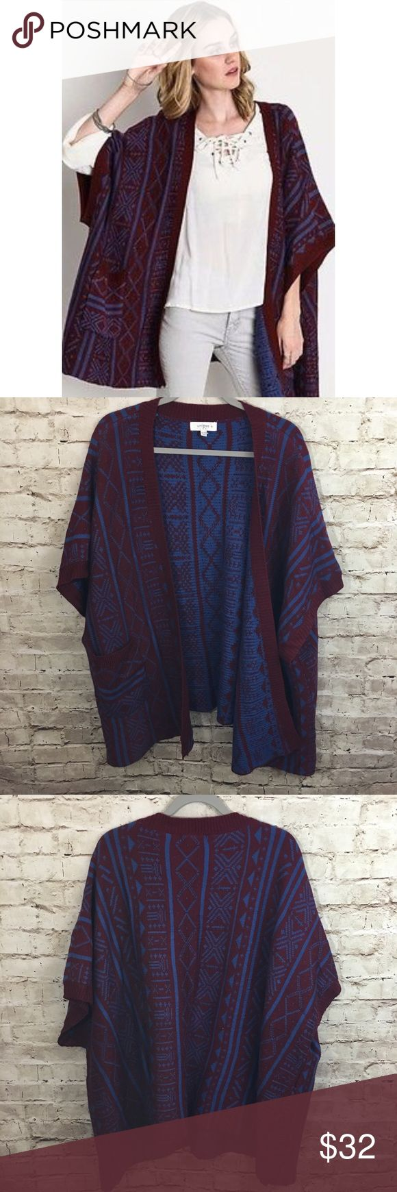 """Umgee Western Tribal Print Open Wrap Cardigan 2XL Instant outfit maker! This Umgee Open Wrap Sweater is in a Western Tribal Print in burgundy and blue. Size 2XL. Thick sweater hits at the hip. Includes pockets! Length 28"""". Excellent Condition with no signs of wear! No holes, stains or pilling! Pair with leggings and skinny jeans with boots and go! Umgee Sweaters"""