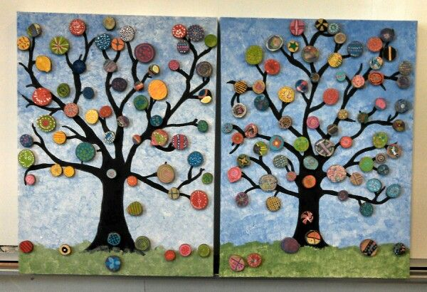 Collaborative art work. Each student in the school has decorated a wooden disc that has been glued to the trees. We are going to sell this via silent auction at the school art show.