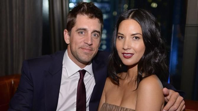 Aaron Rodgers and Olivia Munn.  (Olivia, you are such a beautiful woman, smile! Plus you have an awesome boyfriend!)