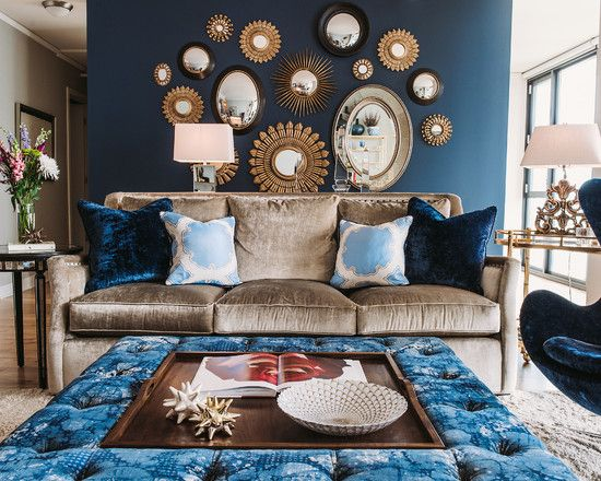 Light-brown-sofa-and-blue-egg-chair-with-mirrored-furniture-dining-room-chandelier-in-dark-blue-accent-wall-for-living-room - Livinator