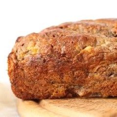 Lots of cinnamon and banana flavor are packed into this healthier whole wheat loaf! Stays moist for days and nobody will have a clue it's made healthier.