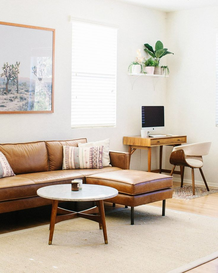 Bright, airy, eye-catching. We're crushing on @ashleytkim's Arizona home today. Living room, leather sofa, desert, mid-century modern