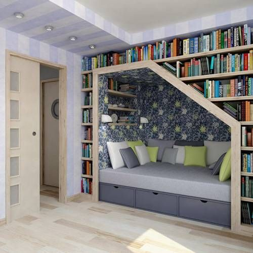 Incoporate a reading area nestled into a bookcase library. What a great use of a wall.