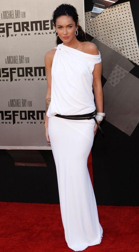 she is wearing a white toga dress