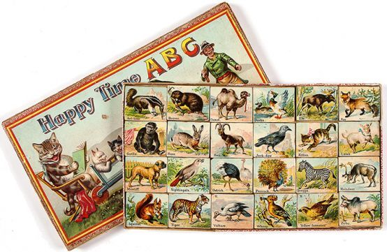 [ALPHABET]. Happy Time A.B.C. A highly attractive set of 24 wooden alphabet blocks featuring chromolithographed images of wild animals and birds. circa 1895. #vintage