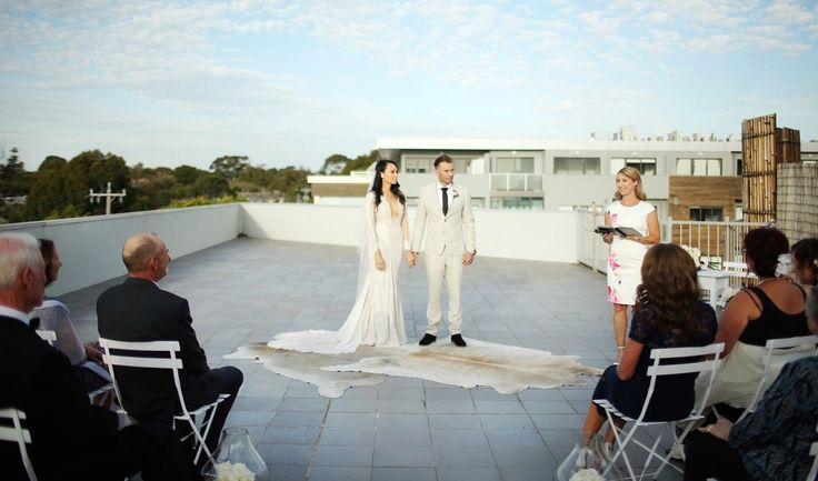 Nat & Pete's rooftop wedding.  Melbourne Celebrant Sally Hughes.  Image: Warrenphotography