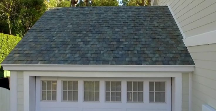 A home with Tesla's French slate solar roofing tiles : Tesla CEO, SolarCity chairman and general billionaire tycoon Elon Musk wants to see every rooftop go solar, but in a way that you don't see where the roof ends and the solar panels start.