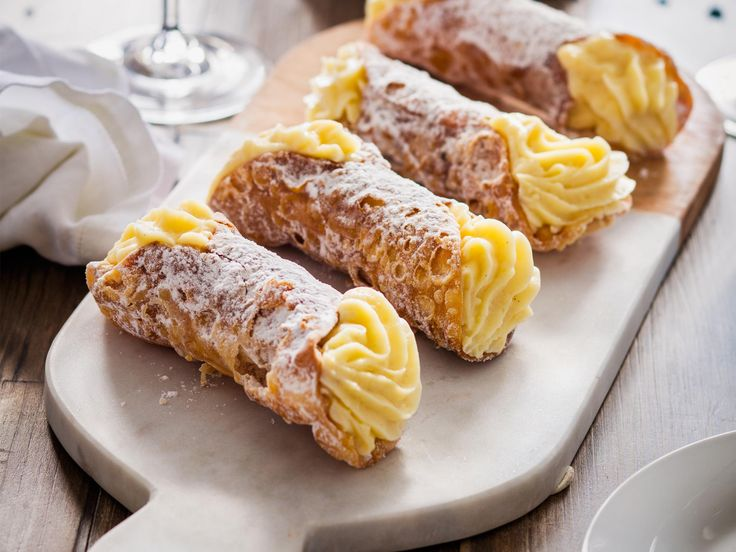 ... classic, cannoli. Crisp pastry tubes are filled with creamy custard