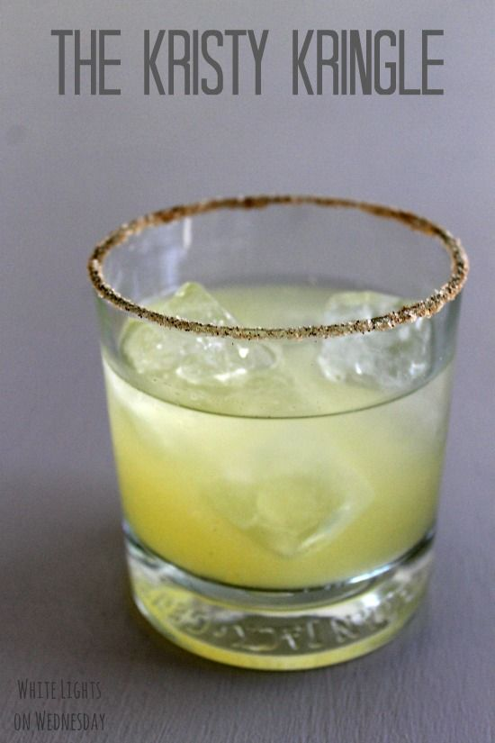 Kristy Kringle ~A light and refreshing cocktail with citrus, ginger, & apple, served in a cinnamon/sugar rimmed glass. ♥ #drinks #cocktails #drinkrecipes