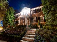 Boxwood hedges frame the staircase leading to the front entry of this Washington, D.C. home.