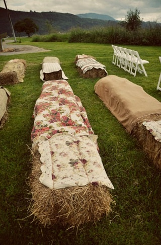 Hay bales covered in blankets for ceremony seating is such a fun twist on traditional seating! Find blankets for rent and/or sale at splendorforyourguests.com!   Splendor for Your Guests | Rental Company | Weddings | Events | Shawls | Blankets | Umbrellas | Parasols | Fans