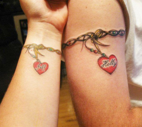 Pretty bracelet tattoos on the arm and the wrist. The pendants hanging from the bracelets carry the name of the couples.
