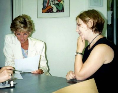 The Princess of Wales talking to a young unidentified applicant at Centrepoint's new Streets Ahead recruitment agency during her visit Monday morning, Aug. 5 1996. The 90-minute visit to the Streets Ahead agency in central London is thought to be the Princess's first engagement since proceedings to end her 15-year marriage began in the divorce court. (AP Photo/PA-POOL)