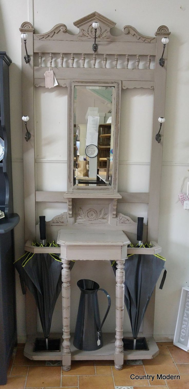 This fab vintage hall stand has been refurbished with new knobs and has been painted in Grand Illusions Vintage Paint 'Mousse'.  See more details at www.countrymodern.co.uk or visit our shop in Norfolk (NR9 5PD)