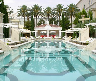 Best Pools in Las Vegas: Garden of the Gods Pool Oasis, Caesars Palace.  All ages, only pool on the strip with swim-up blackjack, 8 different pools.
