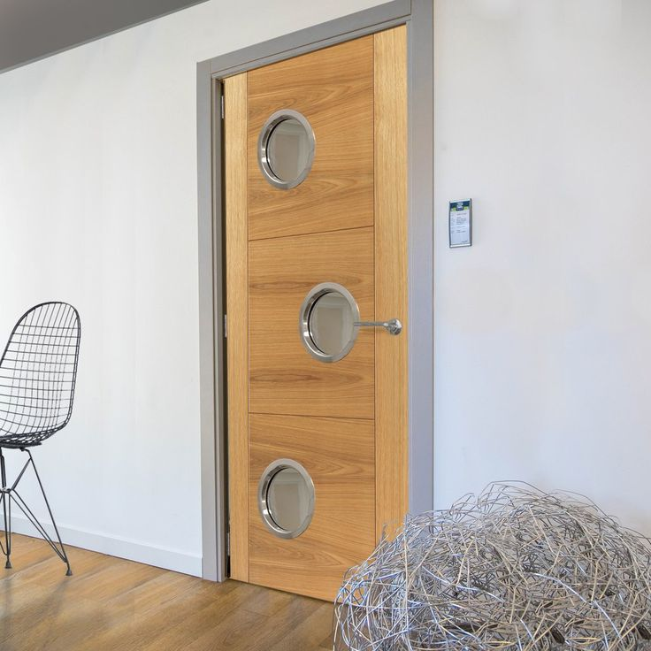 JBK Porthole 3 SP Brisa Mistral Oak Fire Door with Decorative Groove, Pre-finished, 30 Minute Fire Rated , this door will provide good fire safety for your office. #officedoor #modernofficedoor #portholesofficedoor