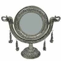 Aranmula Kannadi is a mirror which is a traditional product from Kerala.Buy it online from devotioal store. #AranmulaMirror #AranmulaKannadi #Mirror #MetalicMirror #Aranmula #KeralaTraditional #DevotionalStore