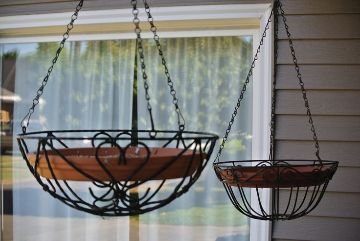 DIY Bird feeder and Bird bath Take hanging baskets and put a pot base inside add water in one and bird feed in the other simple easy and the birdies love it.